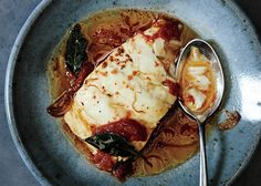 You want to poach the cod in the tomato and saffron broth at a lazy simmer to get a buttery, flaky fish.