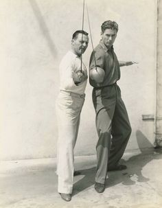 """Errol Flynn with fencing teacher Fred Cavens on the set of Captain Blood Old Hollywood Stars, Hooray For Hollywood, Old Hollywood Glamour, Golden Age Of Hollywood, Vintage Hollywood, Classic Hollywood, Actors Male, Handsome Actors, Actors & Actresses"