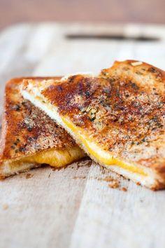 Crispy Garlic Bread Grilled Cheese Sandwiches http://heatherlikesfood.com/crispy-garlic-bread-grilled-cheese-sandwiches/
