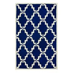Blue wool rug with a trellis motif. Hand-tufted in India.     Product: RugConstruction Material: 100% WoolColor: BlueFeatures: Hand-tuftedNote: Please be aware that actual colors may vary from those shown on your screen. Accent rugs may also not show the entire pattern that the corresponding area rugs have.Cleaning and Care: These rugs can be spot treated with a mild detergent and water. Shake rug from time to time to restore its naturally good looks and beauty.
