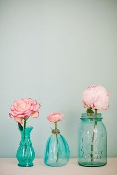 Simple yet so pretty, turquoise glass vases and pink roses, florals by @FairynuffFlower http://www.fairynuff-flowers.co.uk, Photography by @Mnoo http://www.mariannetaylorphotography.co.uk.  See the full feature here http://bit.ly/GQl0xr