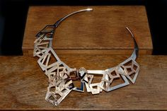 Sterling silver and 9ct yellow gold Aztec necklace.
