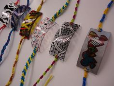 Shrinky Dink fiber jewelry. Other inspiration- scan textile and print. Make a frame and punch holes to use as a loom/necklace. Remember ShrinkyDink mini tags on name tag- spindle, shuttle, knitting needles. Border with couched handspun on hand dyed felt base.