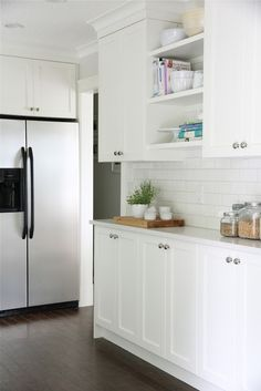 The lower cabinets are the same depth as the upper cabinets which keeps the room feeling spacious but still gives us added storage and counter space.