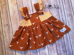 A personal favorite from my Etsy shop https://www.etsy.com/listing/251449905/university-of-texas-baby-dress-texas