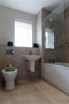 New homes for sale in Southend On Sea, Essex from Bellway Homes Loft Bathroom, Brown Bathroom, Bathroom Inspo, Bathroom Ideas, Bellway Homes Kitchens, Pedestal Sink Bathroom, Large Homes, New Homes For Sale, Beautiful Bathrooms