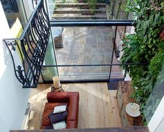 Double height conservatory, upper level: balcony on left, living wall on right