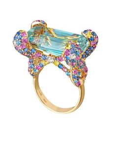 Margot McKinney ring set with a 16.68ct aquamarine with pink and blue sapphires and diamonds.