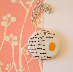 This short porcelain necklace is fired three times (1000 degrees C, 1250 degrees C and 750 degrees C)  Third firing is decal firing - brown and gold pattern.  Porcelain is not glazed, decal is cut by me, each small part is placed by me.  The necklace is 24 cm (9) long.