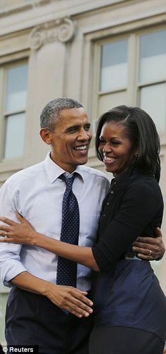 U.S. President Barack Obama and wife, First lady Michelle Obama. This couple is obviously very close and comfortable together.