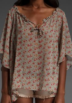 Really like the print. Pretty, soft, rosy, flowy, blouse. I really need to learn how to sew, none of the clothes that i like are anywhere close to my size.