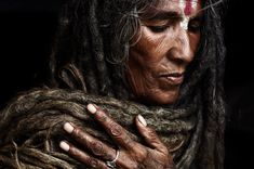 One of the few rare women to take on the the task of becoming a Sadhvi. She has not cut her hair since her husband died, making the ends of the dreadlocks over 10 years old at the time the photograph was taken. Kathmandu, Nepal