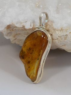 Highly-polished translucent free-form Amber gemstone pendant suitable for men or women, bezel-set in sterling silver, with hinged bail. Amber Necklace, Amber Jewelry, Metal Jewelry, Pendant Jewelry, Sterling Silver Jewelry, Gemstone Jewelry, Gold Jewellery, Amber Gemstone, Unusual Jewelry