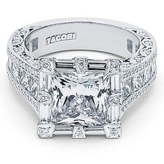 A 3 carat princess cut center diamond surrounded by baguettes of diamonds on the ...