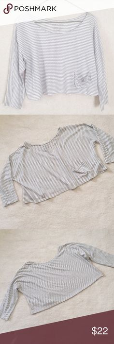 """Urban Outfitters White Gray Loose Fit Crop Top Cute and comfy, loose fit crop top. White and gray, striped, """"brick"""" pattern. Half length or elbow length sleeves. Pocket on left side. Great condition, no stains or tears. Size Small but could fit larger. (8217) Urban Outfitters Tops Crop Tops"""