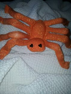 orange glittery sock spider
