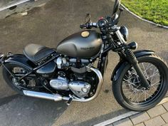 Triumph Bobber      FOR SALE Priced for a quick sale! No offers   Triumph Bobber in the stunning Ironstone colour. This bike has always been stored in a dry damp free garage. Great care and attention to detail taken when cleaned. Maintained regularly. Current mileage is at 2617. EXTRAS installed by Triumph included Vance & Hines exhaust which looks and sounds amazing, Side mounted number plate, Swing arm bag, Rear paddock stand bobbins and heated grips. Al Triumph Sprint, Triumph Bobber, Triumph Motorcycles, Custom Motorcycles, Motorcycles For Sale, Super Bikes, Motorbikes, Bobbers, United Kingdom