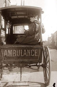 Dr. Elizabeth Bruyn, sitting in the back of a horse drawn ambulance. Dr. Bryun was an ambulance surgeon in New York City.