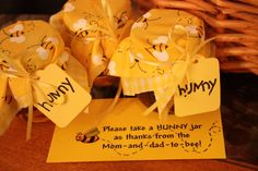 Winnie the Pooh baby shower - baby food jars filled with honey for favors.