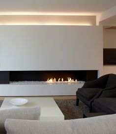 long rectangular gas fireplace insert with glass shards instead of logs