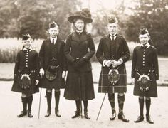 The Children of King George V: Prince George, Prince Albert, Princess Mary, Prince Edward, and Prince Henry.   Only 5 of the 6 children. Prince John is not present in this pic. Had he already past?