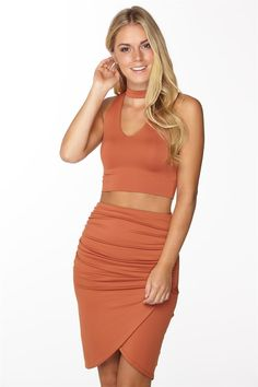 Choker Top is an off the shoulder sleeve crop top, with a high choker style neck. This too cool for words crop top features a double layer of fabric with a super flattering fit. This item is not to be missed by you bodycon babes. 90% polyamide 10% elastane.
