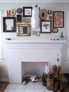 love this art collage (with horse bust!) above the fireplace in Oregon