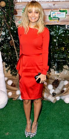 Nicole Richie  WHAT SHE WORE  Richie walked the green carpet at the Baby2Baby Winter Wonderland benefit in a crimson Stella McCartney sweater and peplum skirt. She finished the look with Salvatore Ferragamo pumps and a House of Harlow 1960 clutch.