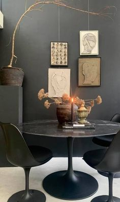 Love this black set of Saarinen table and chairs as seen in artist Margot van Erkelen's studio, all very subdued