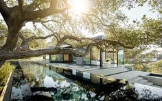 The Oak Pass Main House sits atop a 3.5-acre ridge site with panoramic canyon views