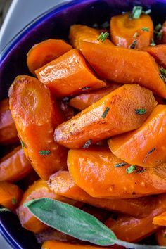 Crockpot Brown Butter Carrots // These sweet tender carrots get a boost from my favorite ingredient of all time: brown butter. An additional secret ingredient that you might not guess puts the flavor of these carrots over the top! A perfect (and EASY) side dish for Thanksgiving or Christmas!