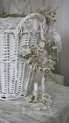 I love white wicker and especially when adorned with delicate floral and candle coupled with it...