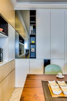 Creative Built-In Storage Maximizes Small Apartment - http://freshome.com/creative-storage-taipei-apartment/