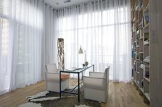 contemporary home office by Sylvia Martin - translucent shades; industrial grommets on stainless steel rod
