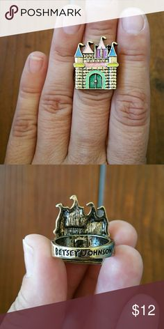 NWOT Sweet Castle Ring I have ALOT of new/unworn jewelry, but I store them all together in a pouch, so if it does not have the tags, I am selling them for less.  This is so precious! Colorful castle on a bronze-toned setting. It fits between a 6 and 7. All proceeds from this sale will go to ES Animal Shelter. Betsey Johnson Jewelry Rings