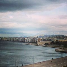 finding poetic inspiration by the majestic sea promenade on a cloudy day