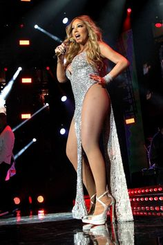 Well then! The diva songstress made sure all eyes were on her when she performed at the <em>Essence</em> Festival in July. Her sparkly dress had just two dangling strips of fabric, in the front and back, with hip-exposing sides. (Photo: Getty Images)