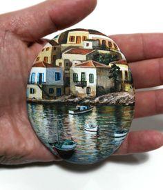 Acrylic miniature painting on flat stone seaside village on