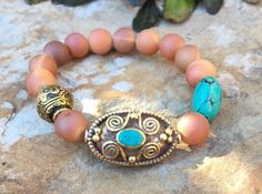 A personal favorite from my Etsy shop https://www.etsy.com/listing/257033270/turquoise-pendant-beaded-bracelet