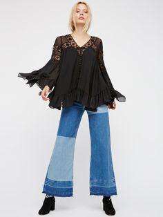 All Night Lace Buttondown | Effortless and femme, this buttondown top features beautiful mesh and lace accents and simple front button closures. Dramatic flared sleeves and a flowy shape. Romantic ruffles at the hem.