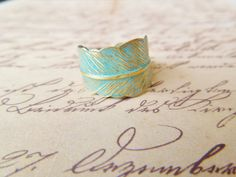 Verdigris Feather Ring - Hand Forged Brass Feather Ring - Shabby Chic, Adjustable. $20.00, via Etsy.
