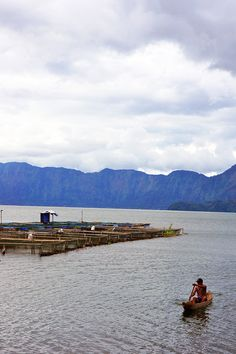 One of the keramba in Lake Maninjau with its owner. Photo by Keshie Hernitaningtyas.