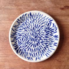 A personal favourite from my Etsy shop https://www.etsy.com/uk/listing/450944654/ceramic-handpainted-handmade-plate-shoal