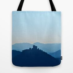 Castle in blue misty mountains Tote Bag A pic of my neo-mystical phase as a companioned artist call this kind of my art. :) It's an undedited photo, taken on a great overlook near to my house. It was a misty and sunny morning, I think that made the color.  The castle on the left is Trifels castle, nearby Annweiler in the Palatinate, Germany. Right of it you see a rock. If it wasn't hazy, you would see 3 more castles behind and beside of Trifels castle. The pass behind Trifels is the border…