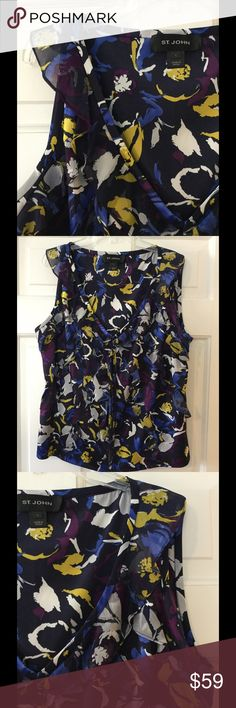 """St. John ruffled silk sleeveless blouse 95% silk, 5% spandex. Dry clean.  Underarm across 21"""". Length 22"""".  Excellent condition. EUC.  Smoke free and pet free. St. John Tops Blouses"""