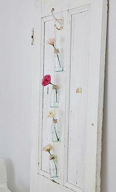 """V i n ⓣ a g e . D e c o r  Love the """"vases"""" on the old door."""
