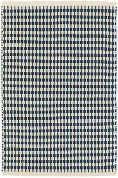 Make some design tracks with this durable and versatile indoor/outdoor rug in a traditional navy blue, part of our Bunny Williams collection. Due to the handmade nature of this area rug, variations in color are expected.Made of 100% PET, a polyester fiber made from recycled plastic bottles.