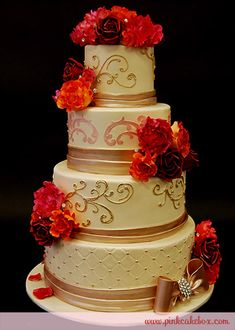 """""""The 1st and third tier is decorated in piping to match the wedding invite. The second tier has light champagne stenciling with a light gold cummerbund with sugar flowers. The bottom tier includes a quilted pattern with metallic (light yellow & rose gold) dots. The bottom tier is topped off with a fondant bow with a brooch and sugar flowers."""""""