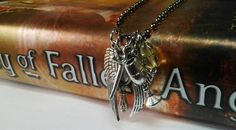 Lovely fan piece - Inspired by by the awesome Mortal Instruments Series ..   *5 charms  wings,sword,cup,mirror   & accent bead  On a 24 inch long chain