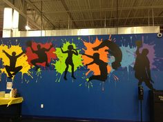 Gym mural, l like the idea color splotches with various sports stencils